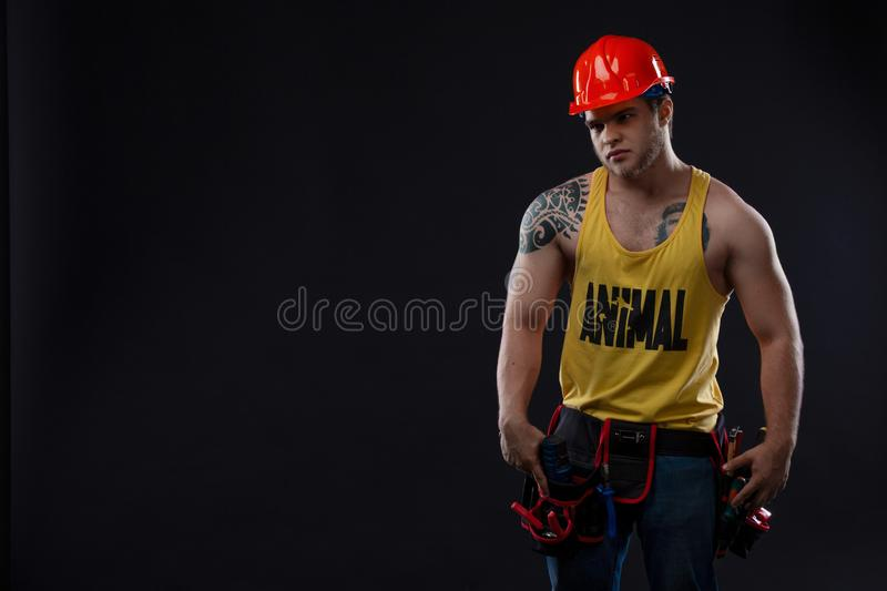 Heavy industry and labour concept - man with confident face expression. Muscle professional builder, repairman in stock photo