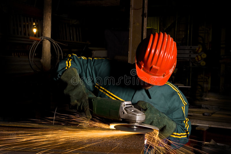 Heavy industry worker with grinder royalty free stock photo