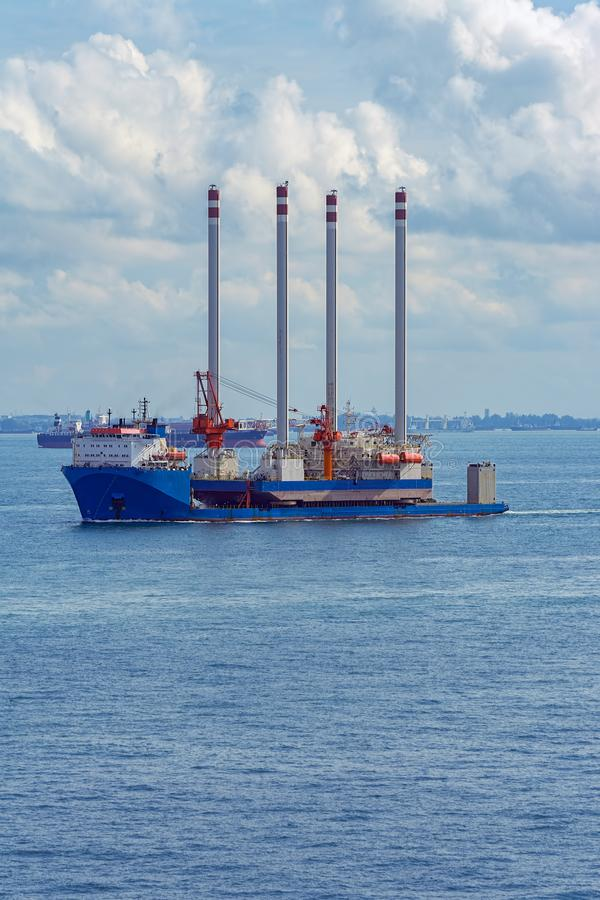 Heavy lift cargo ship transporting an oil rig platform royalty free stock image