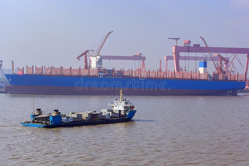 Heavy lift cargo ship transporting an ship sections. royalty free stock photography