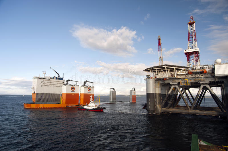 "03. 08. 2014 - The heavy lift vessel Dockwise Vanguard offloading the Semi-Submersible rig ""Ocean Patriot"", outside royalty free stock photography"