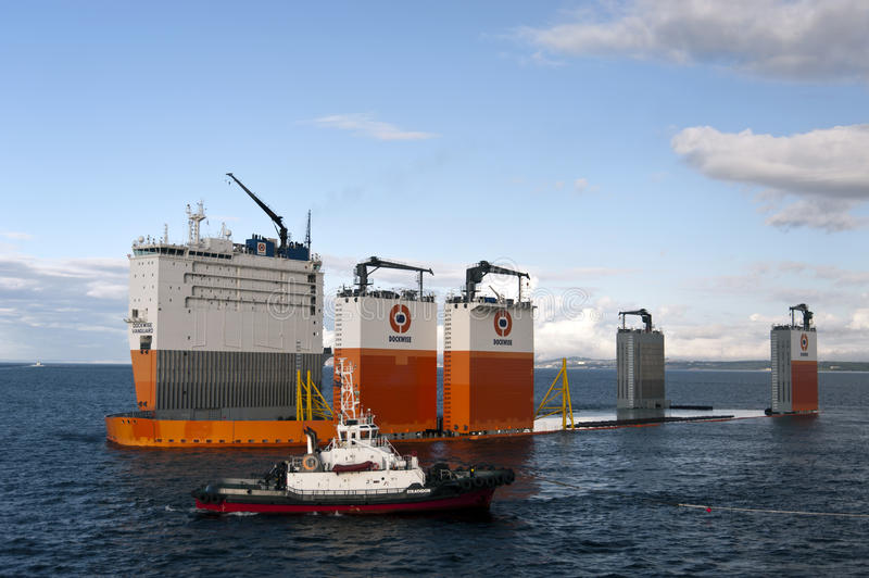 "03.08.2014 - The heavy lift vessel Dockwise Vanguard offloading the Semi-Submersible rig ""Ocean Patriot"", outside Edinburgh. stock image"