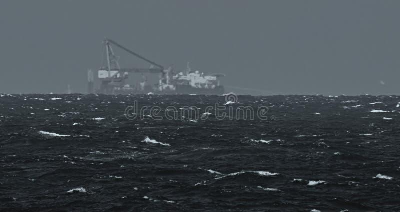 Heavy lift vessel on horizon. Anchor patern royalty free stock photos