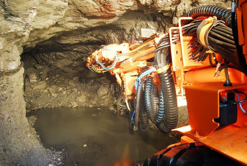 Heavy machine inside a mine shaft royalty free stock photography