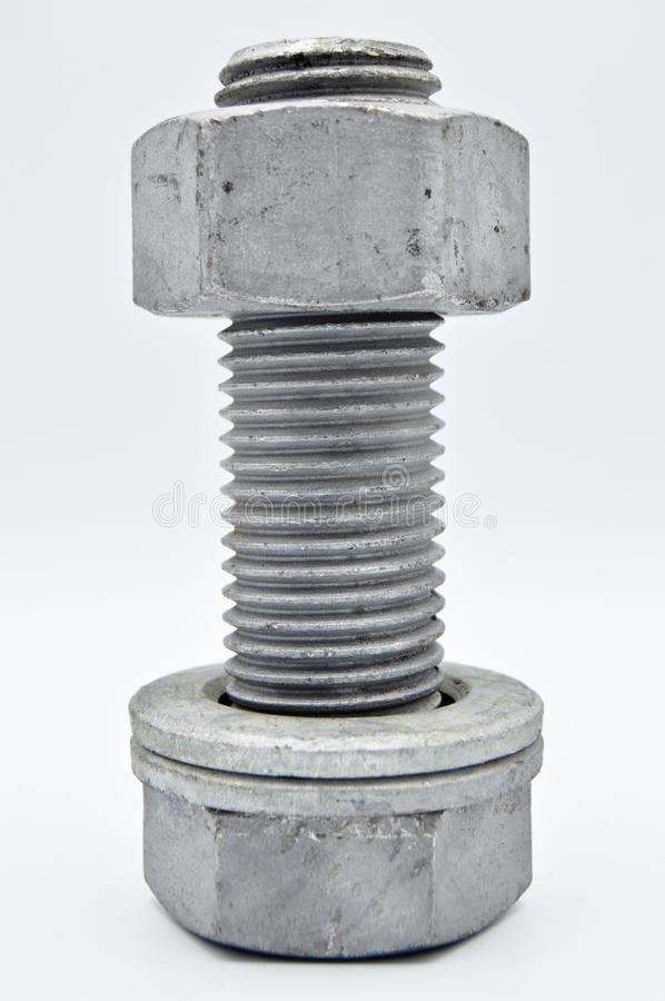 Heavy metal bolt, nuts and washers, tools equipment. stock photography