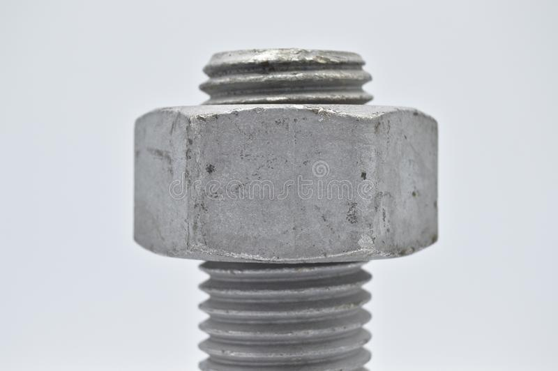 Heavy metal bolt, nuts and washers, tools equipment. On white background stock photos