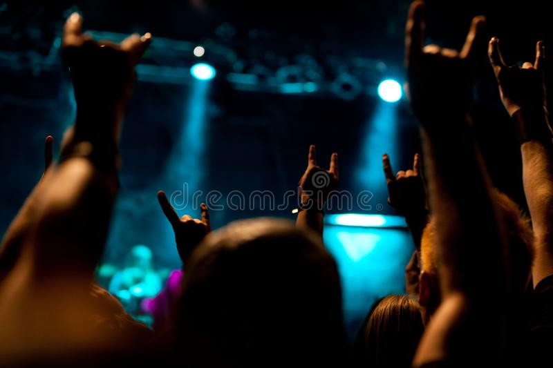 Heavy Metal Concert. People at a heavy metal concert. shot in available with high iso. low depth of field royalty free stock photo