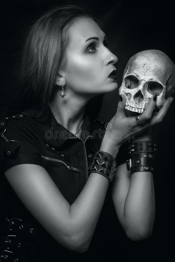 Heavy metal girl with skull royalty free stock photography