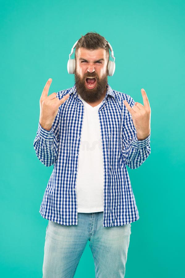 Heavy metal and hard rock. Streaming music sites. Wireless technology. User friendly interface and large library of. Tunes. Hipster with beard listening music stock photography