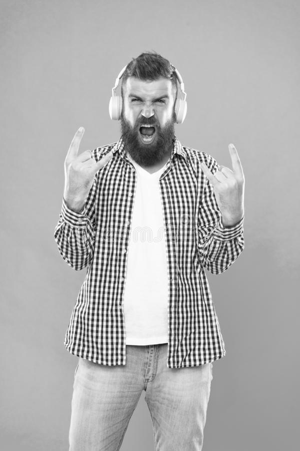 Heavy metal and hard rock. Streaming music sites. Wireless technology. User friendly interface and large library of. Tunes. Hipster with beard listening music royalty free stock image