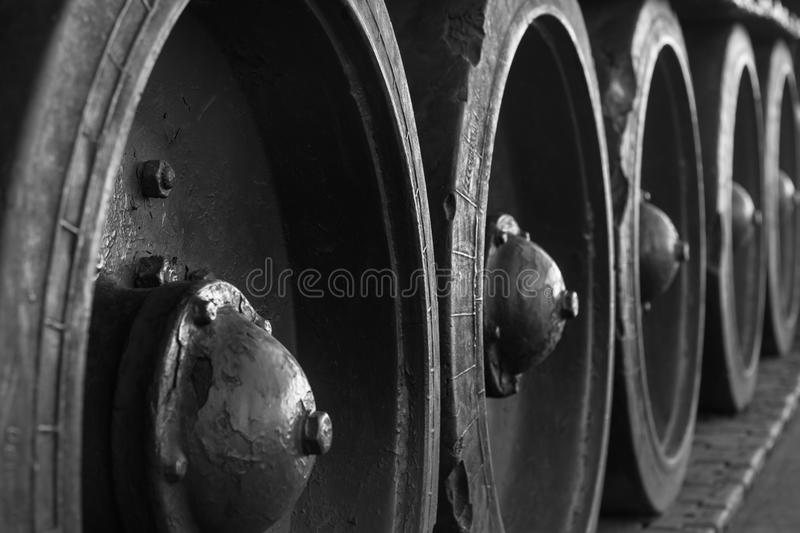 Heavy military equipment. Armament. Military equipment. Tank. Close-up of tank gusinets. Black and white photography royalty free stock image