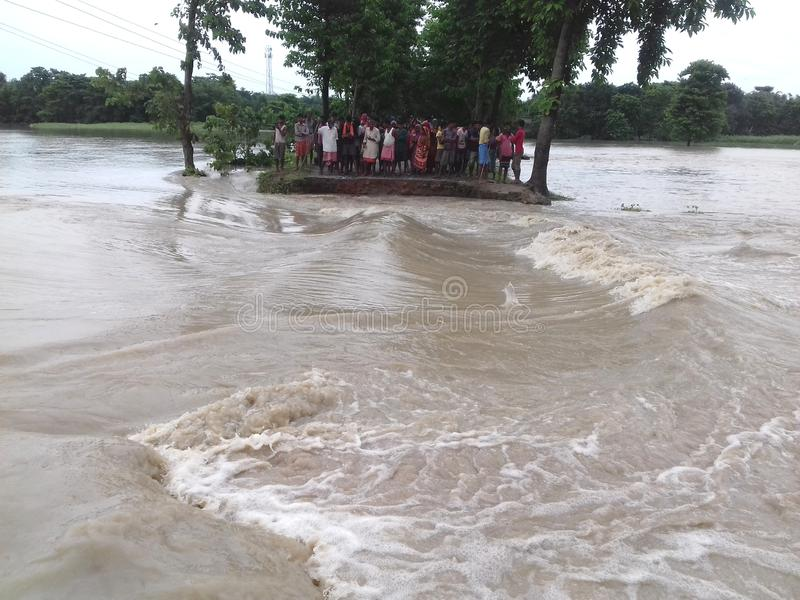 Road cutting in flood. Heavy monsoon rain brings flood in bihar India. This scene captured in forbesganj, a north-east bihar area. communication has break down royalty free stock image