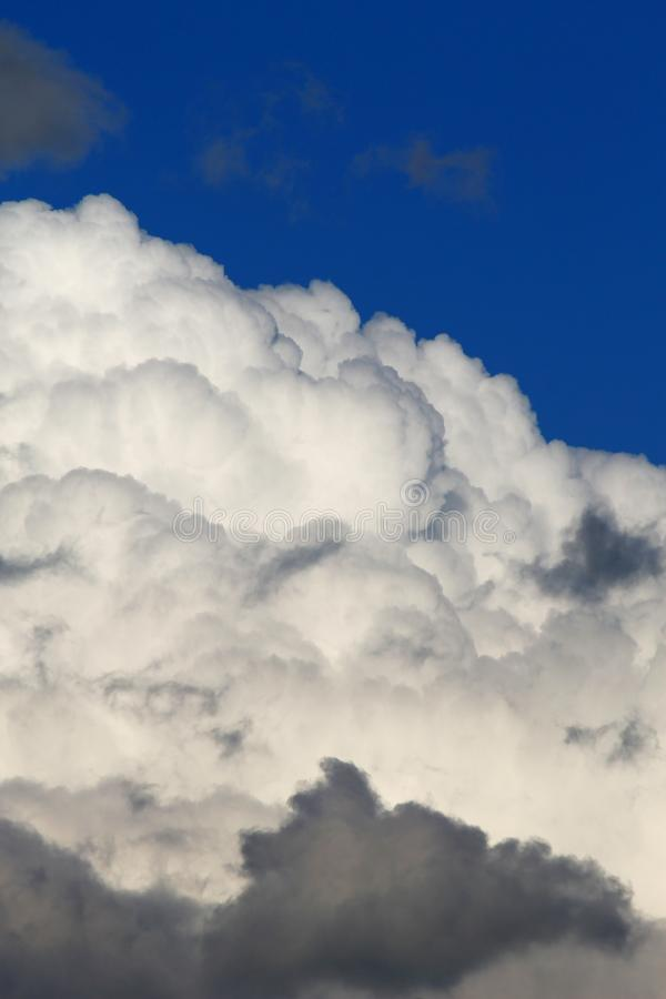 Heavy plumpy clouds on blue sky royalty free stock photo