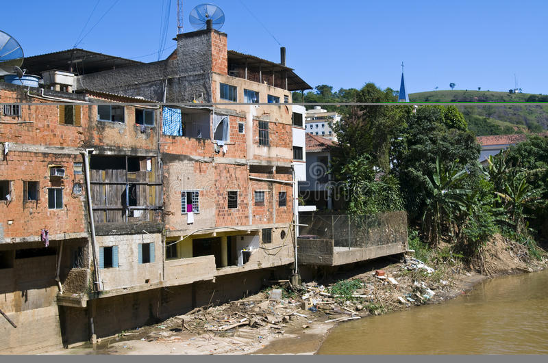 Heavy Pollution. On a river banks of a slum royalty free stock photo