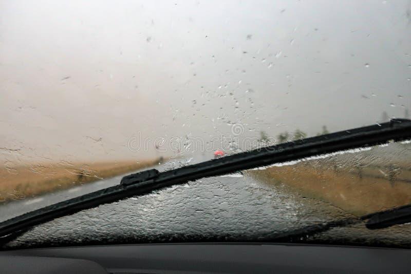 Heavy rain. Cloudburst on windshield. Windscreen wiper. And bad visibility stock photo