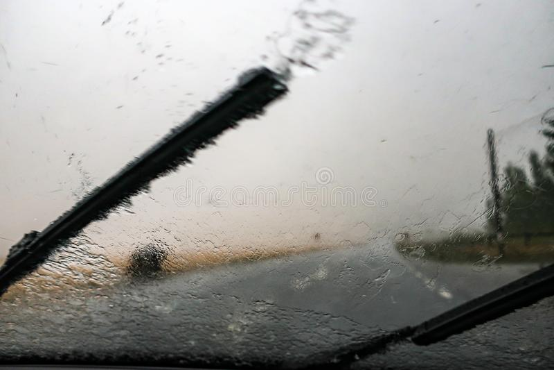Heavy rain. Cloudburst on windshield. Windscreen wiper. And bad visibility royalty free stock photography