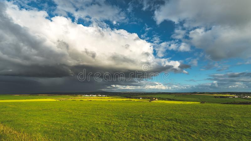 Heavy rainy clouds over the Northern Ireland field royalty free stock image