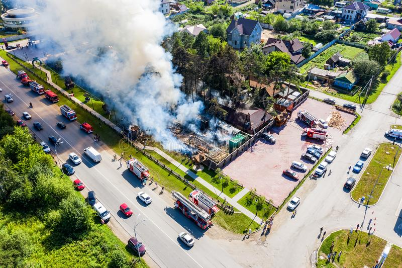 Heavy smoke in burning industrial distribution warehouse or storehouse industrial hangar from burned roof, aerial view royalty free stock photo