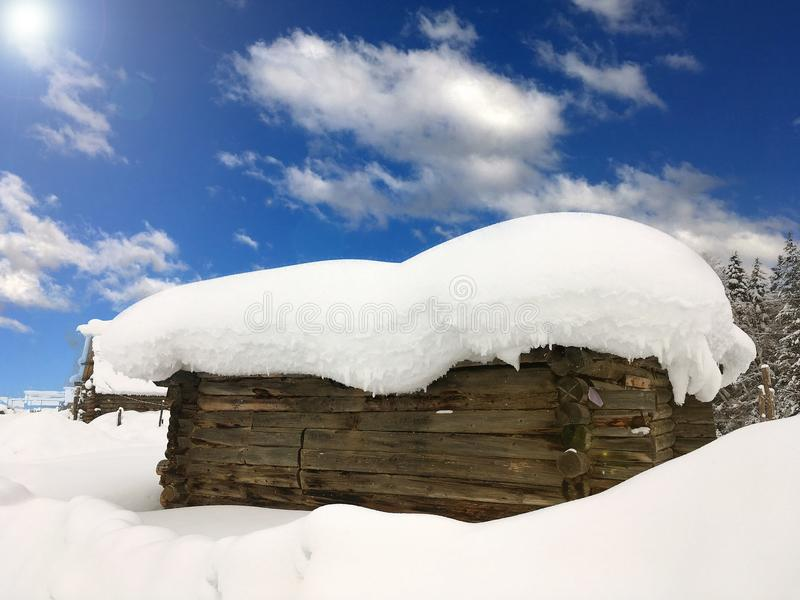 Winter Hemu village in Xinjiang, China. Heavy snow-covered wooden houses in Hemu village in winter. Located within the Kanas Lake scenic area in the north of stock images