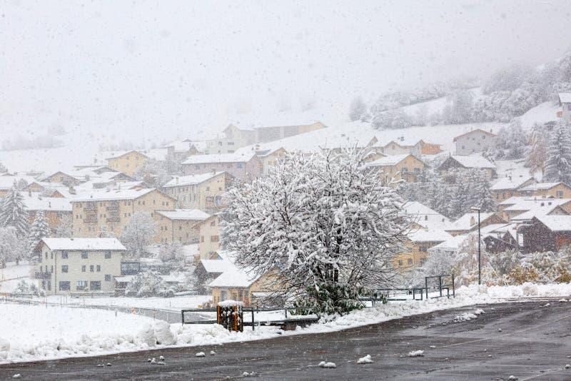 Heavy snowfall in alpine village Muestair. Canton of Graubuenden, Switzerland. royalty free stock images