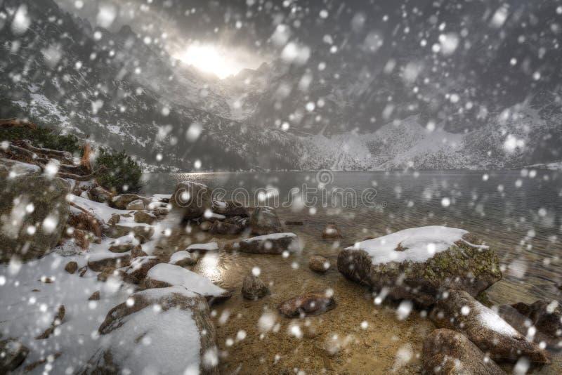 Heavy snowfall at Eye of the Sea lake in Tatra mountains. Poland royalty free stock images