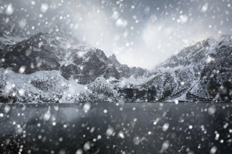 Heavy snowfall at Eye of the Sea lake in Tatra mountains. Poland stock images