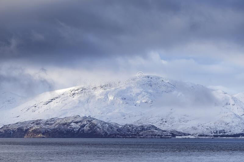 Heavy snows cover the mountains surrounding Loch Leven, Scottish Highlands, UK stock photography