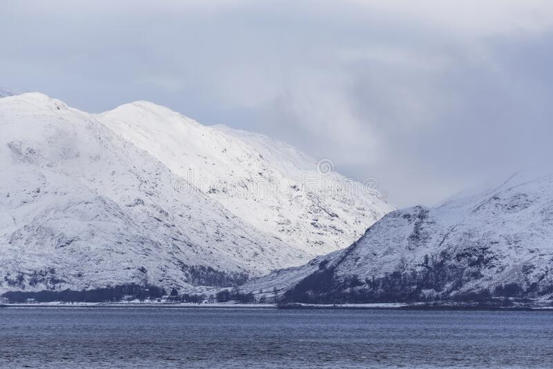 Heavy snows cover the mountains surrounding Loch Leven, Scottish Highlands, UK stock photo
