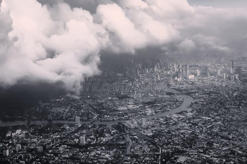 Heavy storm clouds looming over Bangkok, Thailand. Black and white color toning vintage effect. Heavy storm clouds looming over Bangkok, Thailand. Black and royalty free stock photos