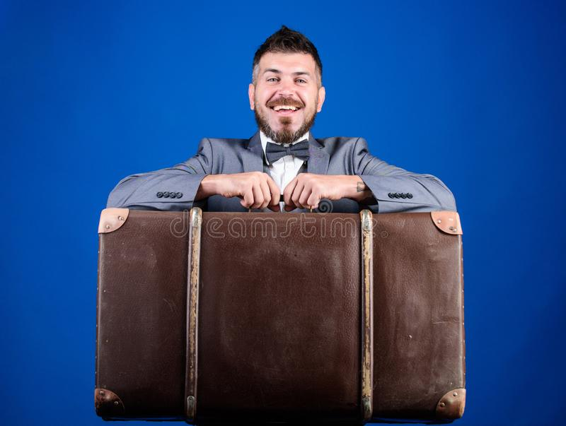 Heavy suitcase. Delivery service. Travel and baggage concept. Hipster traveler with baggage. Baggage insurance. Man well. Groomed bearded hipster with big royalty free stock photos
