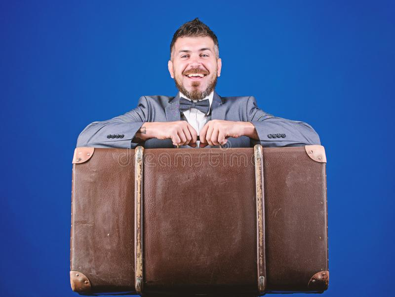 Heavy suitcase. Delivery service. Travel and baggage concept. Hipster traveler with baggage. Baggage insurance. Man well. Groomed bearded hipster with big stock photo