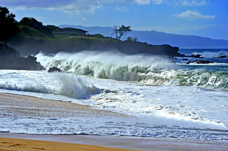 Heavy surf. Large waves roll in on the North Shore of Oahu, Hi. after storms far away in the North Pacific ocean royalty free stock photography