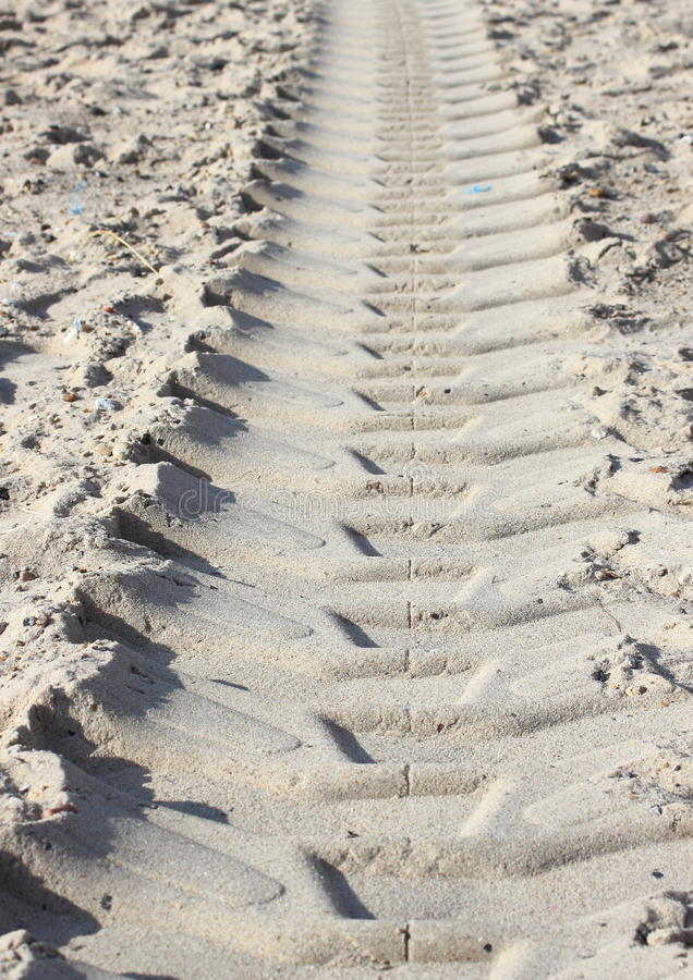 Heavy tractor track in dry beach sand in summer stock image