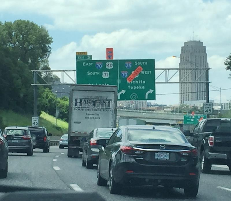 Heavy traffic near Downtown Kansas City, Missouri with signage royalty free stock photos
