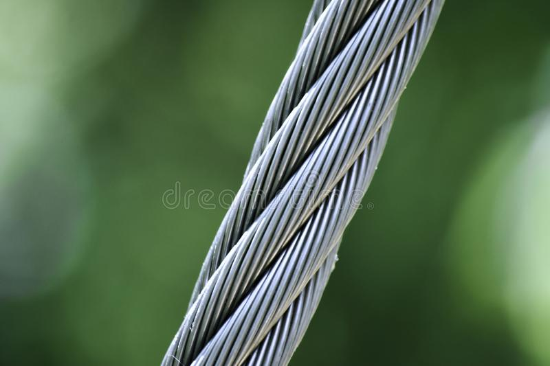 Heavy Twisted Guide Cable on a Suspension Bridge. royalty free stock image