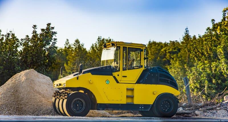 Heavy Vibration roller at asphalt pavement works Asphalt paver road repair Asphalt royalty free stock photos