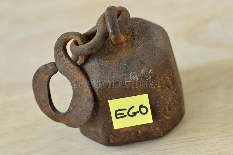 Heavy weight with the word Ego written on paper note - Ego concept royalty free stock image