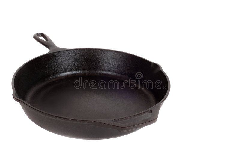 Heavy well worn cast iron skillet stock photo