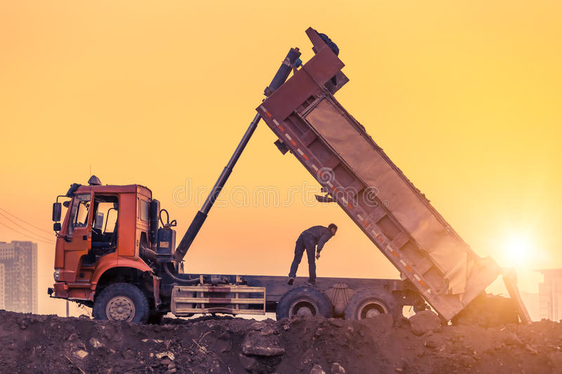 Heavy wheel loader machine working at sunset royalty free stock photos
