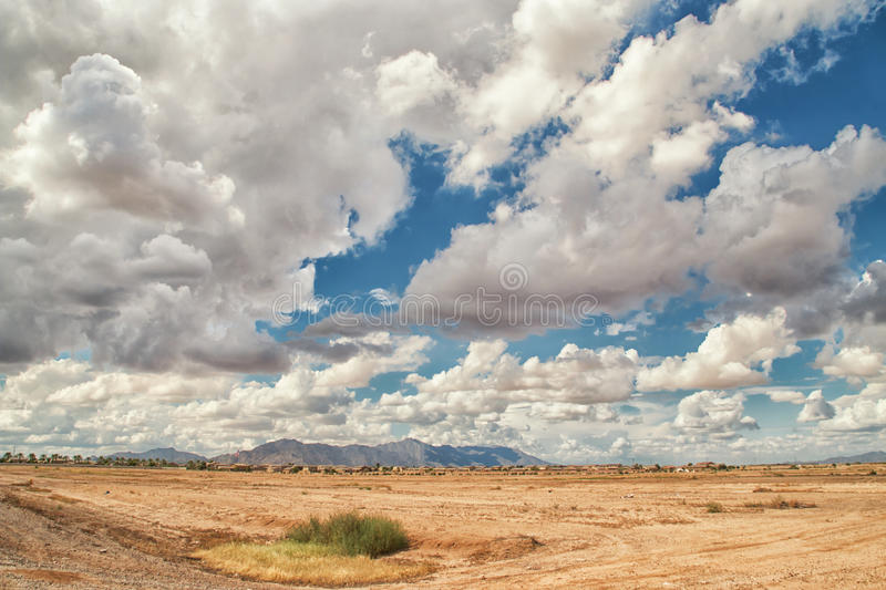 Heavy White Clouds Over The Desert Landscape royalty free stock images