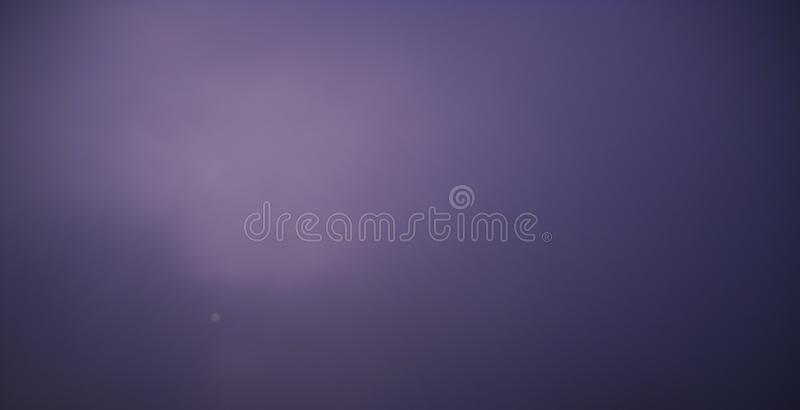 Heavy winter fog and sun almost invisible behind it. Seasonal detail of winter skyscape, in shades of purple. Sun is almost invisible behind heavy winter fog stock photography