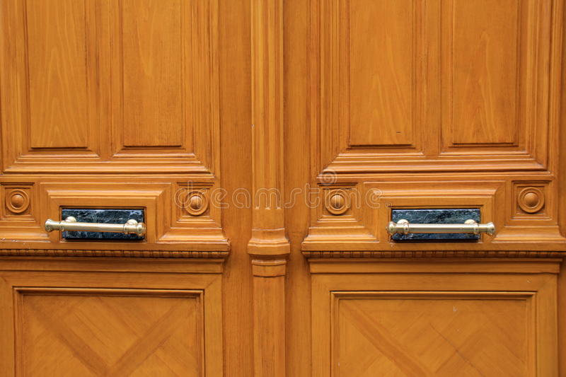 Heavy Wood Doors With Marble And Brass Hardware Stock Photo ...