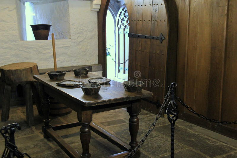 Heavy wood table and display of bowls in one of many rooms,Rock Of Cashel,Ireland,2014 stock image