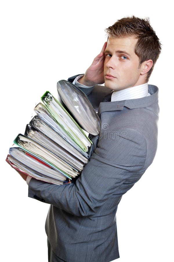 Heavy workload. Stressed businessman with heavy workload royalty free stock photo