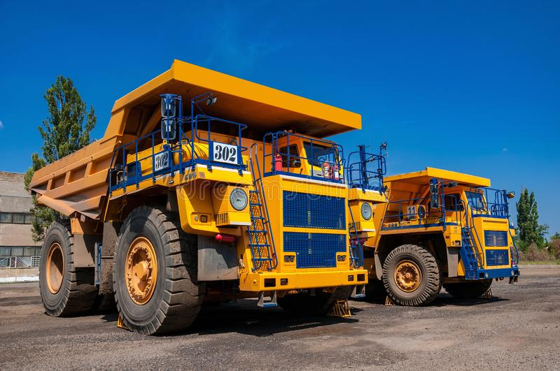 Quarry trucks at repair station stock photography