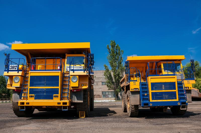 Quarry trucks at repair station stock image