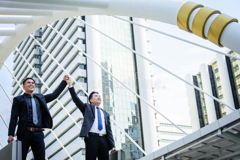 Hebben Aziatische zaken twee overwinning van bedrijfsdoel met de bouw a stock fotografie