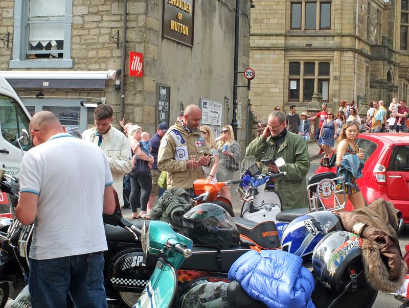 Mods and scooters in hebden bridge for the easter bank holiday monday. Hebden bridge, west yorkshire, england - 22 april 2019: mods and scooters in hebden bridge royalty free stock photo