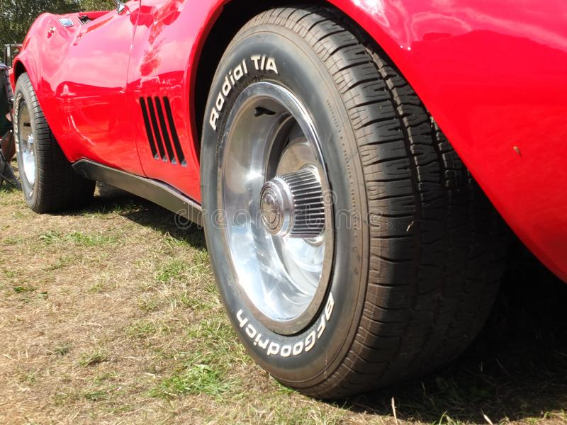 Side view the wheels of a vintage red c3 corvette stingray Sports Car on display at the Annual Hebden Bridge Vintage Weekend publi royalty free stock images