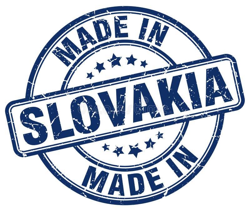 hecho en sello azul del grunge de Eslovaquia ilustración del vector